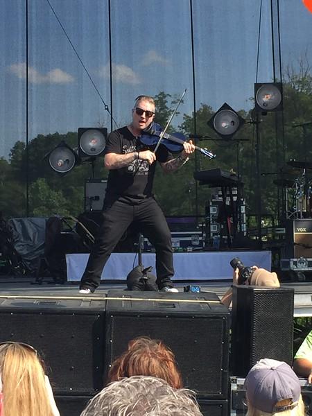 Mark Meszoros -- The News-Herald<br /> Blue October's multi-instramentalist Ryan Delahoussaye performs.