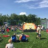 Mark Meszoros -- The News-Herald<br /> Many folks hang out in the large grassy space between the Laurel Stage, seen in the distance, and the Music Elevates Stage.