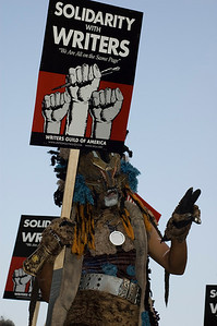 A man dressed as The Lion King character holds a Writers Guild of America Strike sign during a WGA Rally on Hollywood Boulevard November 2007 Photo © Laurie Paladino  2007
