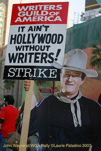 Cardboard cutout of John Wayne holds a WGA Strike sign at Writers Guild of America Rally on November 20, 2007. Hollywood Boulevard, Los Angeles, California