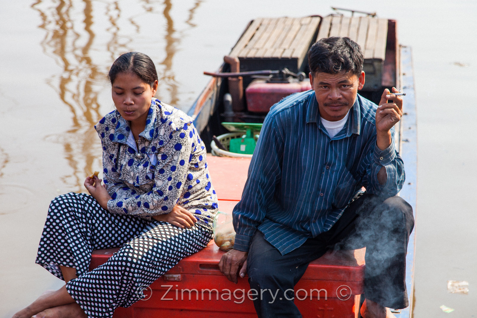 Fisherman and Wife, Floating City, Cambodia