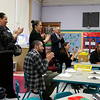 Priest Street School has partnered with the United Way and AIS Corporation to start a mentorship literacy program that will start in September for the 2017 /18 school year. Leominster School Superintendent  Jim Jolicoeur, in far back, applauds with visitors from the United Way and AIS for some of the students after they sang a song for them during a tour of the school on Tuesday morning. They got a tour after announcing the partnership. SENTINEL & ENTERPRISE/JOHN LOVE