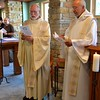 Fr. Ed and Fr. Byron begin the ceremony which took place in the still developing novitiate chapel.