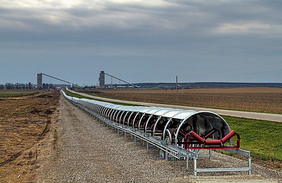 "Conveyor line to the Viper Coal Mine in Elkhart IL. This conveyor system is being built to transport coal from a portal in the next county south of the mine to save on taxes. This system ends up screwing the citizens of Eklhart out of $60,000 a year, 1/3 of their yearly budget! In Williamsburg where the portal is they ""... gave up sales tax revenue in the short run in expectations of both increased sales and property tax revenue, as well as jobs, in the long term."" Don't hold your breath Williamsburg!"