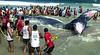 Firemen try for the second day to save a beached humpback whale in Jurujuba beach, suburb of Niteroi, Rio de Janeiro, Brazil,  August 10, 2004. The beached whale dies after three days of rescue efforts. (Foto: Austral Foto/Renzo Gostoli)<br /> <br /> *  Bomberos tratan de salvar una ballena jubarte en la playa de Jurujuba, suburbio de Niteroi, Rio de Janeiro. Pese al esfuerzo a lo largo de 3 dias, la ballena murio en la playa. A  pesar del fracaso en el salvamento de la ballena, este episodio marco um importante cambio de actitud de la poblacion de esta region pues hasta no hace mucho tiempo y  desde epocas coloniales, toda ballena que  aparecia por estas costas era cazada sin piedad y transformada en aceite y otros productos industriales; varias<br />  especies de ballenas, que llegan  a las costas brasilenas en busca de aguas mas calidas, llegaron a estar (y aun estan)  amenazadas de extincion. La participacion de bomberos, biologos, voluntarios y vecinos que se esforzaron, lucharon y se emocionaron  con el rescate de la ballena permite abrigar esperanzas en la preservacion de especies amenazadas de extincion. (Foto:Austral Foto/Renzo Gostoli)