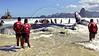 Firemen try for the second day to save a beached humpback whale in Jurujuba beach, suburb of Niteroi, Rio de Janeiro, Brazil,  August 10, 2004.  In the background is a Rio's  panoramic view with Sugar Loaf mountain (right). The beached whale dies after three days of rescue efforts. (Foto: Austral Foto/Renzo Gostoli)<br /> <br /> *  Bomberos tratan de salvar una ballena jubarte en la playa de Jurujuba, suburbio de Niteroi, Rio de Janeiro. Pese al esfuerzo a lo largo de 3 dias, la ballena murio en la playa. A  pesar del fracaso en el salvamento de la ballena, este episodio marco um importante cambio de actitud de la poblacion de esta region pues hasta no hace mucho tiempo y  desde epocas coloniales, toda ballena que  aparecia por estas costas era cazada sin piedad y transformada en aceite y otros productos industriales; varias<br />  especies de ballenas, que llegan  a las costas brasilenas en busca de aguas mas calidas, llegaron a estar (y aun estan)  amenazadas de extincion. La participacion de bomberos, biologos, voluntarios y vecinos que se esforzaron, lucharon y se emocionaron  con el rescate de la ballena permite abrigar esperanzas en la preservacion de especies amenazadas de extincion. (Foto:Austral Foto/Renzo Gostoli)