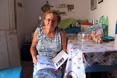 Severina Ferreira da Costa, 81, in her home in Sao Jose do Egito, Pernambuco state. With the local reservoirs dry, all water in the city in the Semi-arid region known as the sertao must be trucked in. Those who can afford it pay to have their home cisterns filled, while others must get wait for government trucks to fill the community tanks. The region has dry season every year, but 2012 is considered the worst in 30 years. (Australfoto/Douglas Engle)