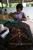 """Workers make hand bags and other products with ecological leather in Maguary on the banks of the Tapajos River in Brazil's Amazonian state of Para, Sept. 3, 2005. The imitation leather is made by a group of artisans from the Maguary community as a way to earn a living from the forest while preserving it at the same time. Began in 1995, the project uses natural rubber from the seringueira trees of the amazon forest to make the """"leather."""" The liquid rubber is spread onto cotton cloth, forming the leather. After it is dry, the material is used to make bags and other items.(AustralFoto/Douglas Engle)"""