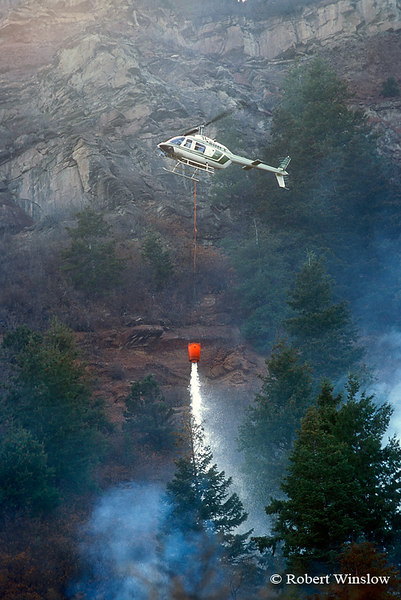 Helicopter Dropping water on Wildland Fire, Falls Creek Area, San Juan National Forest near Durango, Colorado