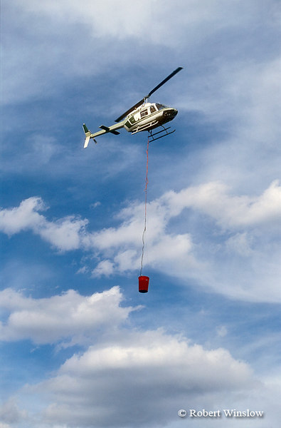 Helicopter Carrying Water from a Lake to Fight a Fire, San Juan National Forest near Durango, Colorado