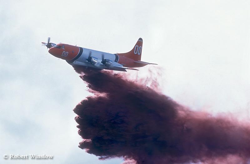 Slurry Bomber Dumps Fire Retardant on Wildland Fire, Falls Creek Area, San Juan National Forest near Durango, Colorado