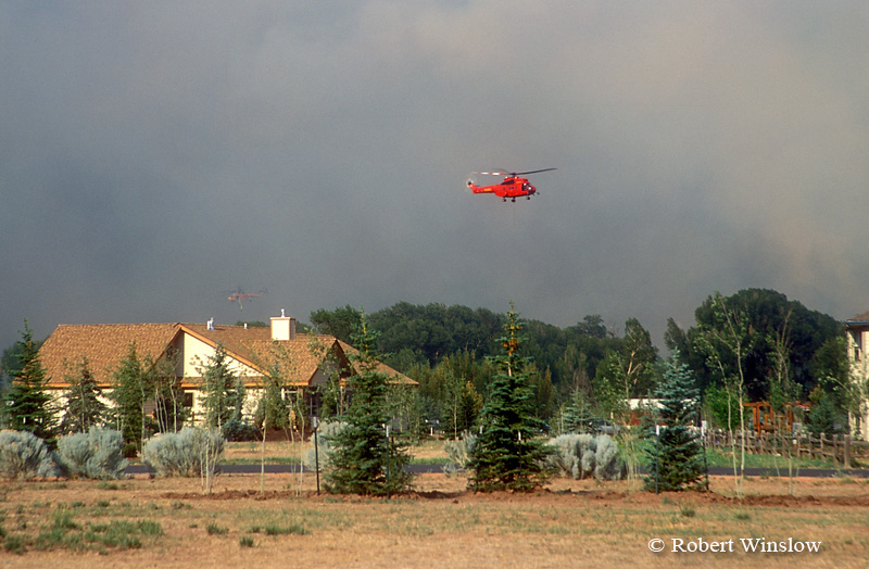 Two Helicopters hover near houses, Missionary Ridge Fire, 2002, Animas River Valley near Durango, Colorado