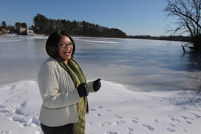 Dianne Sherratt Steimel of Newburyport, on the banks of the Merrimack River at the Southwell Field boat ramp in Chelmsford. She's made a documentary about the river and efforts to clean it. (SUN/Julia Malakie)