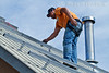 Model Released, Mexican-American Worker preparing to install Photovoltaic Panels on a South Facing Roof, Durango, Colorado, USA, North America