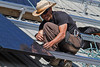 Model Released, Worker installing Schuco 180 W, model MPE 18- MS 05 Photovoltaic Panels on a South Facing Roof, Durango, Colorado, USA, North America