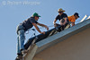 Model Released, Workers installing Photovoltaic Panels on a South Facing Roof, Durango, Colorado, USA, North America