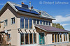 Model Released, Property Released, Workers installing Schuco 180 W, model MPE 18- MS 05 Photovoltaic Panels on a South Facing Roof, House is also Passive Solar,  Durango, Colorado, USA, North America