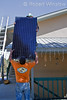 Model Released, Technicians lifting photovoltaic solar panel onto roof for installation, Durango, Colorado, USA, North America