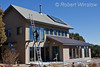 Property Released, Model Released, Man on ladder, Solar Hot Water Panels on the Roof, House is also passive solar, La Plata County, Durango, Colorado, USA, North America