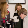 Students use a microscope and monitor to view zooplankton from Lake Tahoe.