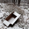 Trash dumped in the woods on the hill between 1st Street and VFW Highway in Lowell.  (SUN/Julia Malakie