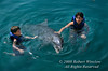 No Model Release, Two Boys Swimming with Dolphins, Xcaret, An Ecoarchaeological Park, State of Quintana Roo, Yucatan Peninsula, Mexico