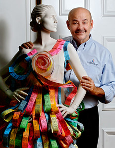 "090315 - DELRAY BEACH - Joe Gillie, outgoing director of Old School Square in Delray, poses for a photo Thursday morning with mannequin wearing a dress by Delray Beach designer Amanda Perna. Amanda Perna, a 28-year-old who lives in Delray Beach, but is originally from Coral Springs, returned to ""Project Runway""  for Season 14.  ""Project Runway"" is on the Lifetime network.  photo by Tim Stepien"
