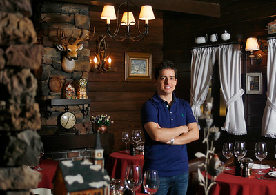 012216 - BOCA RATON - Ricky Marcellini, owner of The Little Chalet in Boca Raton, poses for a photo Friday afternoon at his Boca restaurant.  Photo by Tim Stepien