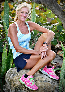 032213 - OCEAN RIDGE - Competitive racer Lee DiPietro poses for a photograph in Ocean Ridge. During her 25 years of competitive racing, Lee has run more the 30 marathons, 6 Ironmans and countless triathlons and road races. At the age of 50, she won her first major marathon winning the overall female title at The Marathon of The Palm Beaches. Photo by Tim Stepien