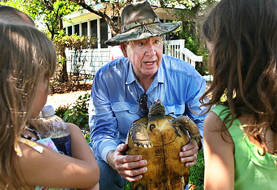 052612 - DELRAY BEACH -Scott McOwen, the veterinarian at the Sandoway House, talks to children about Sir Speedy the gopher tortoise.  Sir Speedy is a permanent resident of Sandoway House.  photo by Tim Stepien
