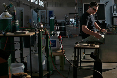 021715 - Lake Worth - Renowned glass artist, Rick Eggert, is the Creative Director of Benzaiten Center for Creative Arts.  Benzaiten's 4,500 square foot glass studio is under his direction and will accommodate up to 8 artisans at a time for studio rentals. The classes will accommodate individuals as well as groups.  Rick works with colleague David Peterson, Glass Studio Manager to produce commissioned works at Benzaiten Center for Creative Arts. Pictured is David Peterson blowing glass.  photo by Tim Stepien