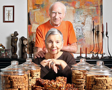 Saturday, April 21, 2012 {} Boca Raton {} 11:15 a.m. Beverly & Jack Circle, photographed Saturday morning in their Boca Raton condo, surrounded by fruitcake and biscotti. Beverly & Jack sell their baked goods at various fundraising events and donate the proceeds to the Boca Raton Museum of Art and its affiliated art school. Beverly & Jack have been married for 62 years.  Photo by Tim Stepien