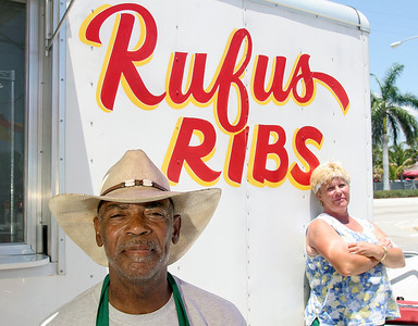 050909 -  Rufus Allen and his wife Brenda Allen. Rufus and Brenda were photographed Saturday cooking and serving ribs and chicken at their roadside stand in Boynton Beach. Photo by Tim Stepien