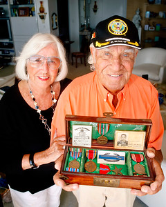 "041214 - SOUTH PALM BEACH - Woody Gorgach, WWII vet, photographed Saturday with his medals and other wwII paraphranelia.  On April 26 Woody will be part of an ""Honor Flight,"" flying to DC to spend the day visiting memorials and flying back to WPB that same night. It's program that honor vets with these day trips.  photo by Tim Stepien"