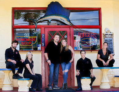 072116 - DELRAY BEACH - Timothy & Adriana McClarney (center), owners of Granger's Bar & Grill in Delray Beach pose for a photo with their staff Thursday morning in front of the establishment.  Photo by Tim Stepien