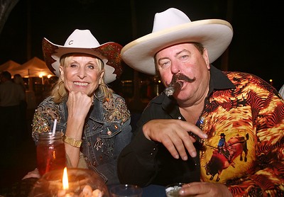 012912 - BOCA RATON - Linda and Frank Palmer photographed Saturday evening at the George Snow Scholarship Fund's 20th Annual Caribbean Cowboy Ball. photo by Tim Stepien