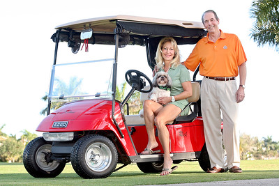 031712 - Rick Dupuis photographed Saturday morning with his wife Gale, their dog, Cappuccino.  Rick was born and raised in Ontario, Canada and moved to Florida some 40+ years ago. He lives in Royal Palm Yacht and Country Club. This year Rick was elected President of the Royal Palm Improvement Association. He immediately worked to improve communications and upgrade the security system throughout the community.  photo by Tim Stepien  Photo Reprints can be purchased online through smugmug at http://smu.gs/GIMVjJ