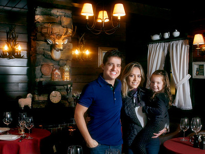 012216 - BOCA RATON - Ricky Marcellini, owner of The Little Chalet in Boca Raton, poses for a photo with his wife Caroline and his Daughter Nina, 3, Friday afternoon at his Boca restaurant.  Photo by Tim Stepien