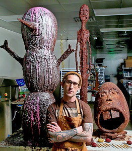 """012019 - DELRAY BEACH - Tyler Levitetz, chocolatier, pictured with a few large chocolate creations at his new store, 5150 Chocolate Co. in Delray Beach. Tyler is a graduate of the L'Art de la Pâtisserie program of the French Pastry School in Chicago. 5150 Chocolate Co., a """"bean-to-bar chocolate factory. Photo by Tim Stepien"""