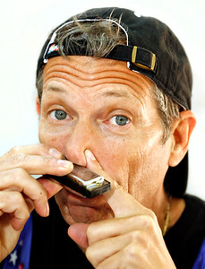 021514 - BOCA RATON - Paul Krohn, AKA Krazy Tyrone, photographed Saturday morning playing the harmonica with his nose at Spanish River Park in Boca Raton.  Photo by Tim Stepien