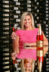 021512 - DELRAY BEACH - Stephanie Miskew photographed Wednesday inside the Seagate Hotel wine room. She is being featured for her involvement with the Boca Baccanal. The Seagate Hotel Beach Club is hosting the vitner dinner for the event.  She lives in Coastal Delray. She also writes a blog about wine and food.  Photo by Tim Stepien