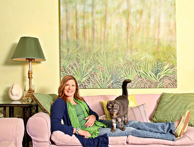 "021513 - OCEAN RIDGE - Elizabeth Thompson and her cat Dallas, a Scottish Fold, photographed Friday at their Ocean Ridge home.  Hanging on the wall is a painting by Elizabeth titled ""Palmetto Morning"", 62 X 70, Oil on Canvas.  Elizabeth will be exhibiting her work, Stories from the Everglades, at Royal Poinciana Plaza, suite 327, opening on March and running through April 5, 2013. A portion of proceeds from the show will benefit the Everglades.  Photo by Tim Stepien"