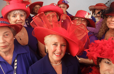 Women of the RED HAT SOCIETY show off their hats in The Palm Beach Post studio.  First Row from Lto R: Proce, Kapp, Lesson, Second Row from L to R: Dawn Corcoran, VanWormer, Hanna, Tournek, Back Row from L to R: Tripp, Parmelee, Duff.  Staff Photo by Tim Stepien