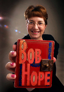 2003 - WEST PALM BEACH - STUDIO -  Vicki Sandberg holding her childhood diary. Vicki Sandberg has a diary that she kept as a girl, filled with her thoughts about Bob Hope and his movies and TV shows. She had a big crush on the guy.  Staff photo by Tim Stepien