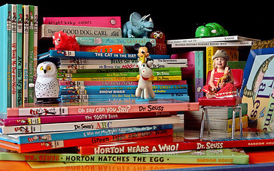 Friday, April 13, 2012  {}  Ocean Ridge Florida {} 5:15 p.m.   Rainy day blues didn't keep me from getting my Photo of the Day.  I created a playful scene with my daughter Jade's favorite books and toys, photographed her, composited it together in adobe photoshop . Illustration by Tim Stepien