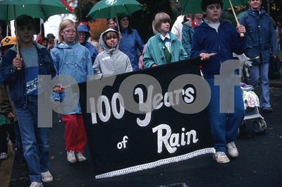 "On Nov. 11, 1989 school children carried this banner, 100 years of Rain"", in the Starte's centennial parade in downtown Olympia."