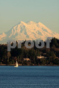 The view east across Budd Inlet to Mt. Rainier from the Olympia Country Club .
