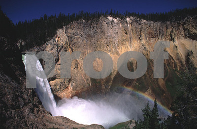 A rainbow forms in Lower Yellowstone Falls in Yellowstone National Park, WY.