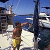 Pacific blue marlin, Makaira mazara , beig weighed at Honokohau Harbor, boat captain slaps the flank of the dead billfish to bring back the stripes, Hawaii (Central Pacific Ocean)