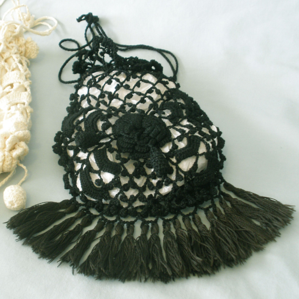 Drawstring purse crocheted by Susan Veronicia (Lukens) Keating.